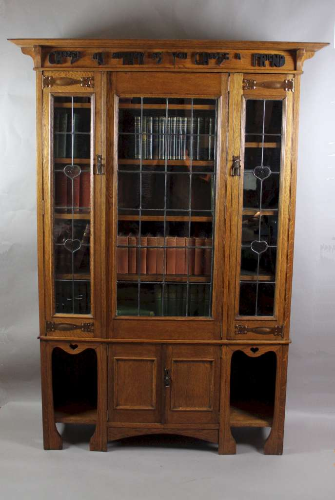 arts and crafts oak glazed bookcase with motto latest. Black Bedroom Furniture Sets. Home Design Ideas